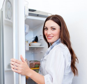 happy woman after refrigerator repairs